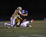 Oxford High's Nick Brown (18) is tackled by Lafayette High's Eli Murphree (6), who is called for a face mask penalty, at Bobby Holcomb Field in Oxford, Miss. on Thursday, August 30, 2012. Oxford High won 19-0.