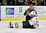 3 December 2011: University of Vermont Catamount forward Kyle Mountain, a Freshman from Bryn Mawr, PA, is tended to by UVM Athletic Trainer Steve Basiel, during game action against the University of Maine Black Bears at Gutterson Fieldhouse in Burlington, Vermont. The Catamounts fell to the Black Bears 5-2 in the second game of their 2-game Hockey East weekend series. Mandatory Credit: Ed Wolfstein Photo