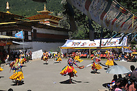 "Monks performing at Bumthang Tsechu at Tamshing Monastry. The Tshechu is a festival honouring Guru Padmasambhava, ""one who was born from a lotus flower."" This Indian saint contributed enormously to the diffusion of Tantric Buddhism in the Himalayan regions of Tibet, Nepal, Bhutan etc. around 800 AD. He is the founder of the Nyingmapa, the ""old school"" of Lamaism which still has numerous followers. The biography of Guru is highlighted by 12 episodes of the model of the Buddha Shakyamuni's life. Each episode is commemorated around the year on the 10th day of the month by ""the Tschechu"". The dates and the duration of the festivals vary from one district to another but they always take place on or around the 10th day of the month according to the Bhutanese calendar. During Tshechus, the dances are performed by monks as well as by laymen. The Tshechu is a religious festival and by attending it, it is believed one gains merits. It is also a yearly social gathering where the people, dressed in all their finery, come together to rejoice. Arindam Mukherjee."