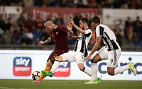 Calcio, Serie A: Roma vs Juventus. Roma, stadio Olimpico, 14 maggio 2017. <br /> Roma&rsquo;s Radja Nainggolan, left, kicks to score as Juventus&rsquo; Miralem Pjanic, center, and Mehdi Benatia try to stop him during the Italian Serie A football match between Roma and Juventus at Rome's Olympic stadium, 14 May 2017. Roma won 3-1.<br /> UPDATE IMAGES PRESS/Isabella Bonotto