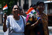 Woman carries Indian flags while they take part in the annual Indian independence day parade in New Jersey,  August 11, 2013. Photo by Eduardo Munoz Alvarez / VIEWpress.