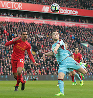 Burnley's Ashley Barnes eyers up a volley under pressure from Liverpool's Joel Matip<br /> <br /> Photographer Rich Linley/CameraSport<br /> <br /> The Premier League - Liverpool v Burnley - Sunday 12 March 2017 - Anfield - Liverpool<br /> <br /> World Copyright &copy; 2017 CameraSport. All rights reserved. 43 Linden Ave. Countesthorpe. Leicester. England. LE8 5PG - Tel: +44 (0) 116 277 4147 - admin@camerasport.com - www.camerasport.com