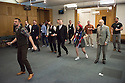 London, UK. 23.02.2015. A Lindy Hop dance class is held at Portcullis House, Westminster, hosted by DanceUK, with MPs as guests, to launch the Dance Manifesto.  Strictly's Jenny Thomas and Robin Windsor teach the class, whilst Bic Graham, from The Lindy Club,  DJs. Picture shows:Robin Windsor (Strictly Come Dancing Choreographer) teaching Dancers and MPs some basic steps. Photograph © Jane Hobson.