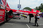 Jun. 17, 2011; Bristol, TN, USA: Crew members lift the body of the car driven by NHRA funny car driver Cruz Pedregon during qualifying for the Thunder Valley Nationals at Bristol Dragway. Mandatory Credit: Mark J. Rebilas-