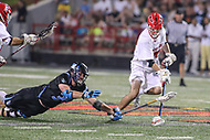 College Park, MD - April 29, 2017: Johns Hopkins Blue Jays Hunter Moreland (31) dives at Maryland Terrapins Nick Brozowski (24) during game between John Hopkins and Maryland at  Capital One Field at Maryland Stadium in College Park, MD.  (Photo by Elliott Brown/Media Images International)