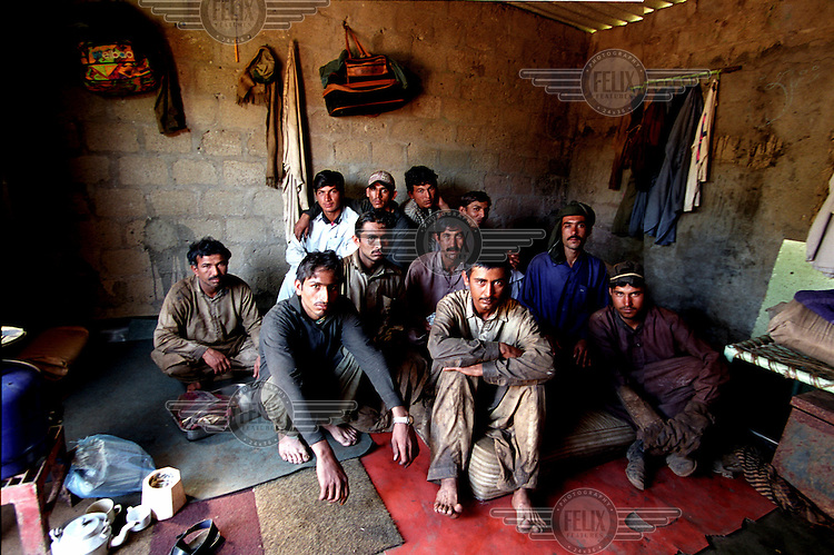 The tenants of a single room in the ship-breaking yard in Gaddani. All are from the rural north of the country, forced to migrate for work due to the infertile land and a shortage of jobs.