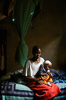 35 year old Vaida Tawa cradles her one year old son Russell after they were attacked with a golf club by Zanu PF supprters who recognised them as MDC (Movement for Democratic Change) supporters one week before the Zimbabwe 29 March 2008 General Elections...
