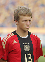 Germany's Bjorn Kopplin (13) stands on the field before the match against Brazil during the FIFA Under 20 World Cup Quarter-final match at the Cairo International Stadium in Cairo, Egypt, on October 10, 2009. Germany lost 2-1 in overtime play.