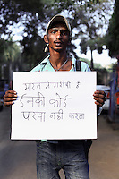 Alu - 19 yrs.Bombay.Hindu.Street hawker selling maps of India.Hindi - 'India has poor people, nobody cares for them'.