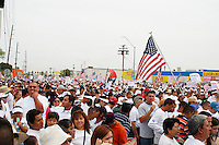"Phoenix, Arizona. April 10, 2006 - Tens of thousands of immigrants from Latin America congregated at the grounds of the Veteran's Memorial Coliseum in Phoenix to march to the Arizona State Capitol. The march was one of many that took place around the country in 2006. Immigration marches totaled millions of illegal immigrants -all together- who for the first time took their plea for immigration reform to the streets. The protest in Phoenix and others in many other states in the U.S. protested a proposed legislation called ""Border Protection, Anti-terrorism, and Illegal Immigration Control Act of 2005,"" also known as H.R. 4437 or Sensenbrenner Bill. This legislation sought to increase penalizations for illegal immigration and make undocumented immigrants and those who helped them enter or stay in the country as felons, and an additional 700 miles of fence along the U.S.-Mexico border, among other provisions. The marches pushed for a comprehensive reform of the immigration laws in the U.S., and a path to citizenship for all undocumented immigrants. Photo by Eduardo Barraza © 2006"