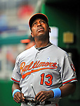 19 June 2011: Baltimore Orioles' Bench Coach Willie Randolph watches the score from the dugout during a game against the Washington Nationals on Father's Day at Nationals Park in Washington, District of Columbia. The Orioles defeated the Nationals 7-4 in inter-league play, ending Washington's 8-game winning streak. Mandatory Credit: Ed Wolfstein Photo