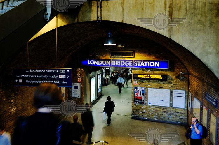 People going into London Bridge underground station.