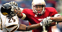 Stiff Arm&amp;#xA;Washington State running back Jerome Harrison stiff arms Grambling State defensive back DeMichael Dizer on his way to a first down. Harrison ran for 113 yards and three touchdowns.&amp;#xA;<br />