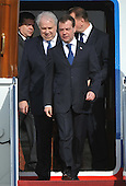 Russian President Dmitry Medvedev (C) and Russian Ambassador to the U.S. Sergey Kislyak arrive for the Nuclear Security Summit, at Andrews Air Force Base, Maryland, April 12, 2010.  .Credit: Kevin Dietsch / Pool via CNP