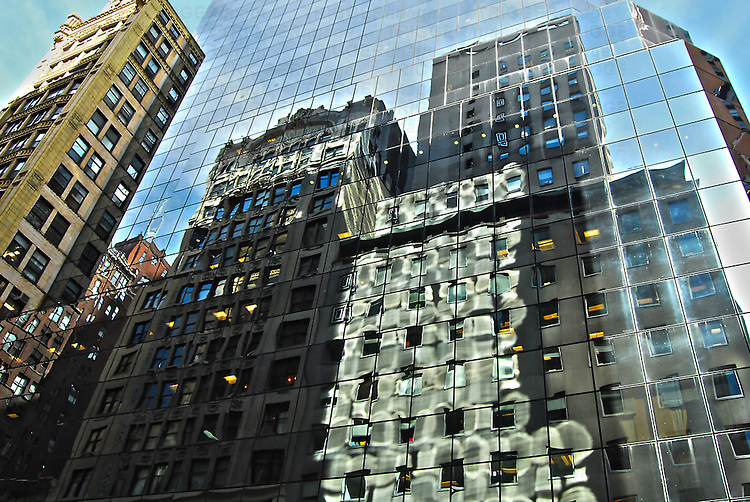 Reflections in the windows of buildings in Midtown Manhattan, New York City.