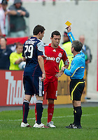 22 May 2010: Toronto FC defender Dan Gargan #8 and New England Revolution midfielder Marco Perovic #29 both receive a yellow card during a game between the New England Revolution and Toronto FC at BMO Field in Toronto..Toronto FC won 1-0.....