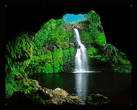 """Waikaumalo Cave: A tranquil waterfall in the uplands of Waikaumalo Stream as viewed from inside a deep lava tube, Hawai'i Island. Shot on 4x5"""" transparency film, available only as a fine art print."""