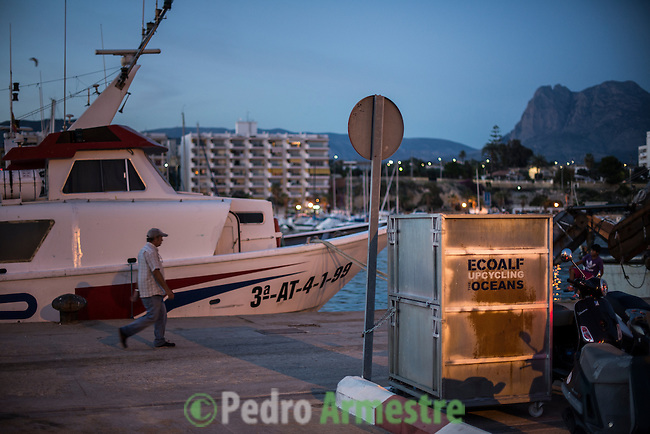 """A picture taken on November 4, 2015 shows a container with plastic waste collected in the sea in the harbour of Villajoyosa . Ecoalf, a Spanish Madrid-based firm founded in 2010, has already launched """"a new generation"""" of clothes and accessories made from plastic bottles, old fishing nets and used tires found on land.    © Pedro ARMESTRE"""