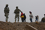 U.S. troops with 3rd Squadron, 2nd Cavalry Regiment direct curious children away from an American patrol near Muqdadiyah, Iraq. The soldiers are part of Operation Iron Harvest, which is meant to kill or capture al Qaida fighters who fled to rural areas of Diyala province after the U.S. troop surge in Baghdad and Baqubah last year. Jan. 23, 2008. DREW BROWN/STARS AND STRIPES