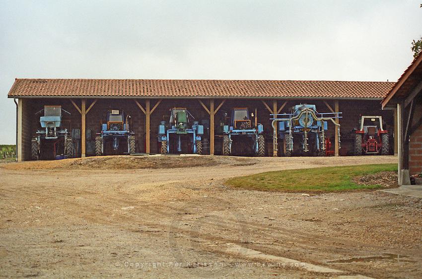 Winery building. Mechanical harvesting tractor. Chateau la Tour de By, Medoc, Bordeaux, France