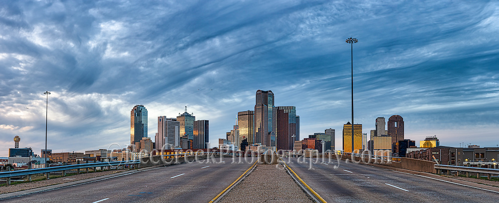 Dallas panorama of the skyline at dusk from a slightly different angle of the city.  On the far left you can see the Reunion Tower and the Omni Hotel then right in the middle are the traditional buildings like Fountain Plaza, Bank of America, Chase Tower, Comerica,