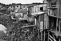 Wooden stilt houses seen in a poor neighborhood of Manaus, Brazil, 2 April 2004. Amazonia is the world's largest dense tropical forest area. Since the 16th century the original indigenous people have been virtually pushed away or exterminated. The primal ancient unity between tribes and the jungle ambient has changed into a fight between the urban based civilization and the jungle enviroment. Although new generations of white and mestizo settlers have not become adapted to the wild tropical climate and rough conditions, they keep moving deeper into the virgin forest. The technological expansion causes that Amazonia is changing rapidly.
