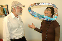 "Artist Les Light discusses his art piece entitled, ""Mobius Band"" with Senior Arts Foundation curator Myung Deering during his premier solo collage exhibit on Sunday, April 10, 2011."