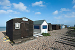 Beach huts at Kingsdown, a popular fishing area near Walmer, Kent, UK
