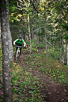 Riding The Flow trail while mountain biking in Copper Harbor Michigan Michigan's Upper Peninsula.