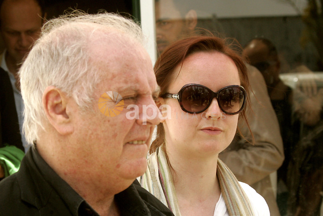 "Israeli conductor Daniel Barenboim arrives to the Gaza Strip at the Rafah border terminal between Egypt and the Palestinian coastal strip on May 03, 2011 before his ""peace concert"" which marks the first time that Barenboim, an outspoken proponent of peace between Israel and the Palestinians, has visited Gaza. The composer, who holds Israeli, Argentine and Spanish passports, in 2008 accepted honorary Palestinian citizenship saying he hoped the move would be an example of the ""everlasting bond"" between Israelis and Palestinians. Photo by Abed Rahim Khatib"
