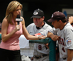 06/17/2006  Georgia head coach  David Perno gets interviewed by ESPN's Erin Andrews in the fifth inning during, game 3 of the College World Series in Omaha Nebraska Saturday afternoon..(photo by Chris Machian /Minorwhite Studios)