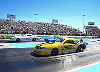 Sept. 22, 2013; Ennis, TX, USA: NHRA pro stock driver Jeg Coughlin (near lane) races alongside Shane Gray during the Fall Nationals at the Texas Motorplex. Mandatory Credit: Mark J. Rebilas-