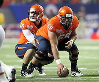 ATLANTA, GA - DECEMBER 31: Anthony Mihota #68 of the Virginia Cavaliers hikes the ball to Michael Rocco #16 of the Virginia Cavaliers during the 2011 Chick Fil-A Bowl against the Auburn Tigers at the Georgia Dome on December 31, 2011 in Atlanta, Georgia. Auburn defeated Virginia 43-24. (Photo by Andrew Shurtleff/Getty Images) *** Local Caption *** Michael Rocco;Anthony Mihota