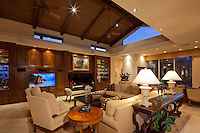 Nightime view of large living room with wooden ceiling and clerestory windows
