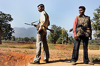 Salwa Judam Militia stand guard against a possible Naxalite attack during repolling in the village of Pandewar. The first polling a few weeks before had resulted in the Naxalites destroying the (EVM) electronic voting machine and warning the villagers their hands would be chopped off if they voted again.