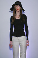 Model poses in an outfit from the Rosa Pusher Fall Winter 2012 collection presentation, by Tammy Pusher, during New York Fashion Week Fall 2012.