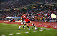 Egypt's Islam Ramadan (12) attempts to control the ball against Costa Rica's Diego Madrigal (11) during the FIFA Under 20 World Cup Round of 16 match between Egypt and Costa Rica at the Cairo International Stadium on October 06, 2009 in Cairo, Egypt.