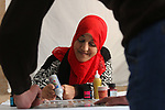 """Sawsan Al Khalili, 40 years-old, a Palestinian woman of special needs paints in Gaza city on Feb. 11, 2017. Al Khalili secretary general of the general union of the Palestinian disabled and a head of the Palestinian farsat club for women with disabilities and she has a degree in law and information technology. """"I defend the rights of the disabled and became their ambassador in six European countries"""" Al Khalili said. Photo by Samar Eliwa"""
