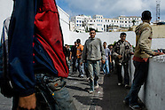 Young Moroccan immigrants observe the port of Tanger to enter illegaly in it and to try to escape from Morocco, 17 June 2007. Every day tens of Moroccan young men try to cross ilegally the Strait of Gibraltar. ?Harraga? (immigrants in Arabic) come to Tanger from all over Morocco. They try their good luck and hidden between the wheels of a truck they attempt to board on a ferry and get to Spain, eventually further to Europe. Considering the thorough checks at the port only few of them make it. Therefore they spend months living on a beach, in huts along the walls of the port, begging for food and waiting for the right night so as their dream about Europe came true.
