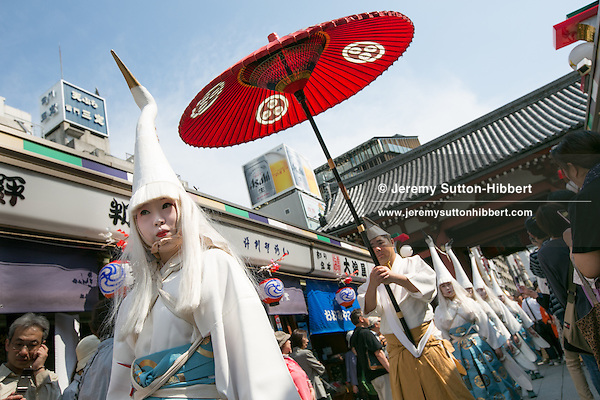 The first of three days of celebrations of the Sanja Festival, in Asakusa district, in Tokyo, Japan, May 18th 2012. The Sanja Matsuri, or Sanja Festival, is held annually in May, and is considered one of the three great Edo festivals of Tokyo. The procession on the first day of the festival is known as Daigyoretsu and consists of traditional dancers, musicians and performers. The women dressed as white egret birds were taking part in the Shirasagi-jinji event (the ritual holy event of cranes), and performed a dance known as Shirasagi-no-mai (the egret's dance). The dance was initially known for getting rid of bad luck, but now is performed to carry on the tradition of Heian-era's graceful culture.