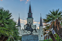 Andrew Jackson Statue in the Jacson Square in the French quarters in New Orleans at dusk.  The statue is located in the square in front of the Saint Louis Cathedral and this area is the oldest part of New Orleans and a mecca for toursit and locals. Nearby you can find lots of shops, restaurants or ride the ferry or have dinner cruise on the Natchez.  The rail runs allong this route so you can catch a ride somewhre else.