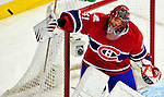 22 March 2010: Montreal Canadiens' goaltender Jaroslav Halak deflects a shot during the second period against the Ottawa Senators at the Bell Centre in Montreal, Quebec, Canada. The Senators shut out the Canadiens 2-0 in their last meeting of the regular season. Mandatory Credit: Ed Wolfstein Photo