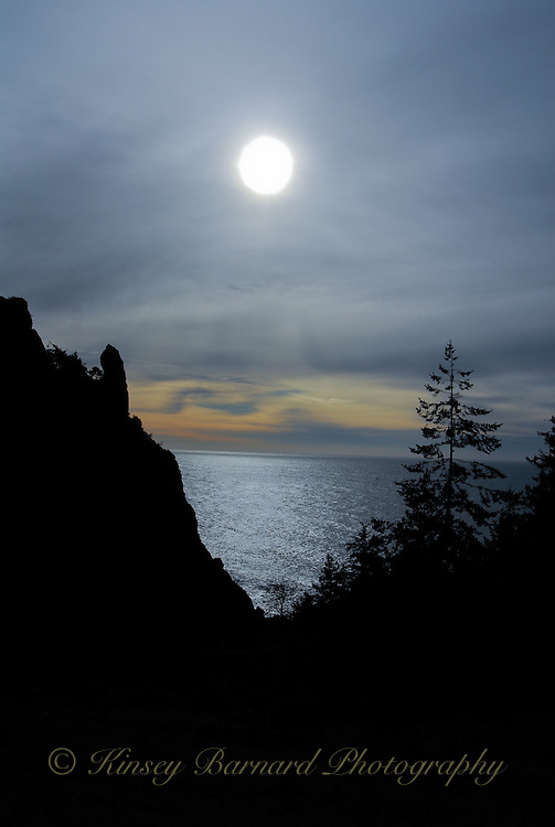 &quot;SOON TO BE EVENING&quot;<br /> <br /> Sunset on the oregon coast blue clouds and rock silhouettes frame a sparkling sea