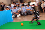 A soccer playing robot is demonstrated at a university in Tokyo, Japan.