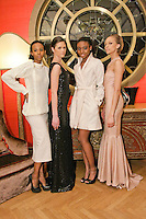 Models pose in an outfits from the Romas by Linda Rowe Thomas, Fall/Winter 2011 collection, during New York Fashion Week.