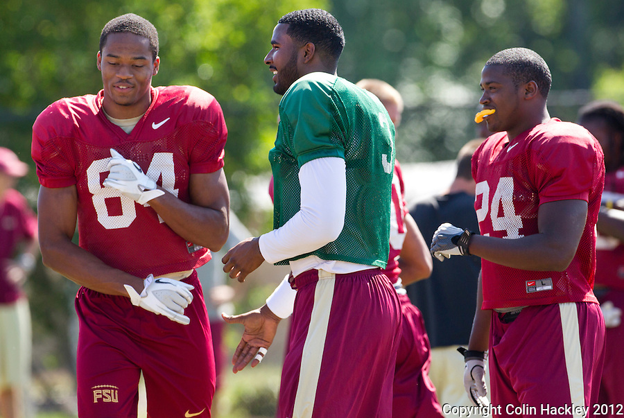TALLAHASSEE, FLA.4/2/12-FSUFB040212 CH-FSU quarterback EJ Manuel, center, shares a laugh with Rodney Smith, left, and Lonnie Pryor  during spring football practice April, 2, 2012 in Tallahassee...COLIN HACKLEY PHOTO