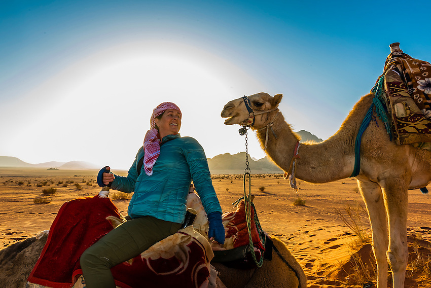 Tourist on camel ride in Arabian Desert, Wadi Rum, Jordan.