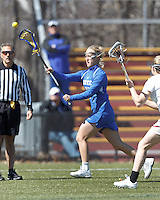 Duke University midfielder Chelsea Landon (7) passes the ball. Boston College (white) defeated Duke University (blue), 10-9, on the Newton Campus Lacrosse Field at Boston College, on April 6, 2013.