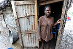 A woman in the doorway to her home in Batey Bombita, a community in the southwest of the Dominican Republic whose population is composed of Haitian immigrants and their descendents.
