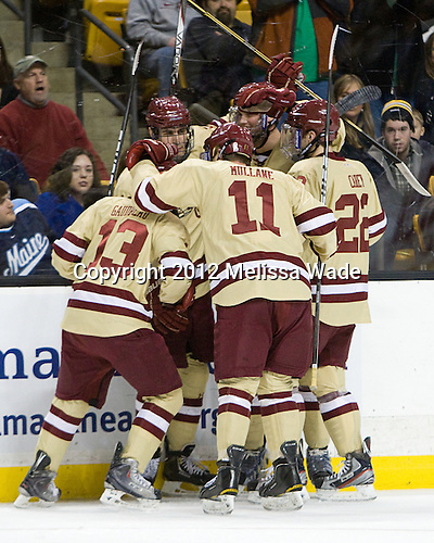 Johnny Gaudreau (BC - 13), Chris Kreider (BC - 19), Pat Mullane (BC - 11), Brian Dumoulin (BC - 2) and Paul Carey (BC - 22) celebrate Gaudreau's goal. - The Boston College Eagles defeated the University of Maine Black Bears 4-1 to win the 2012 Hockey East championship on Saturday, March 17, 2012, at TD Garden in Boston, Massachusetts.
